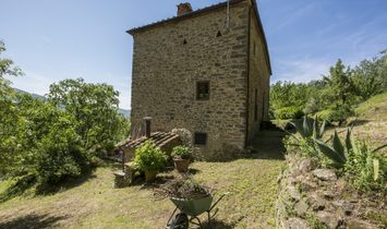 Medieval Farmhouse Immersed In The Green Of The Tuscan Hills