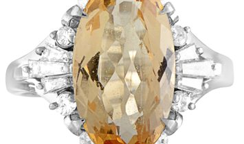 Non Branded Platinum Round and Tapered Baguette Diamonds and Imperial Orange Oval Topaz Ring