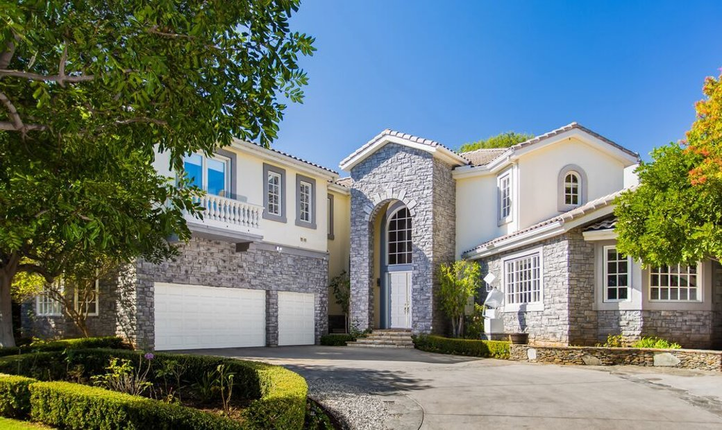 Majestic, private and gated, custom-built estate located in the heart of Brentwood