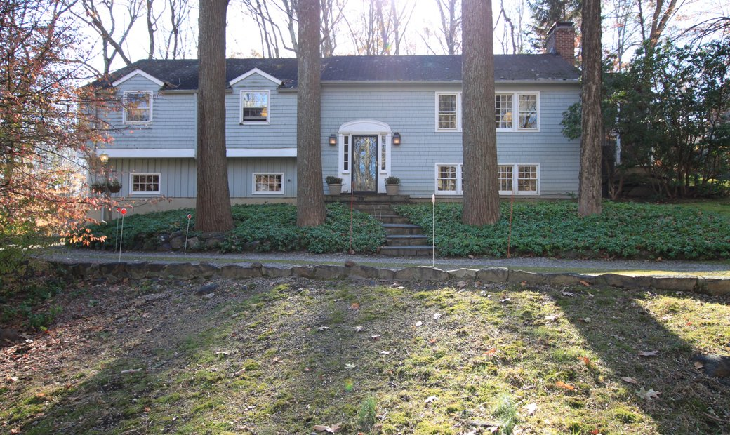 Lovely Raised Ranch In Wooded Setting