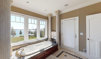 Stunning Location On Lake Charlevoix Sits This Custom Built Home