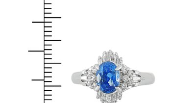 Non Branded Platinum Round and Tapered Baguette Diamonds and Sapphire Ring