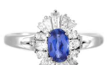 Non Branded Platinum Round, Tapered Baguette and Pear Diamonds and Sapphire Oval Ring