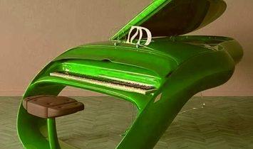 Beautifully Stylish Self-Playing Curva Piano