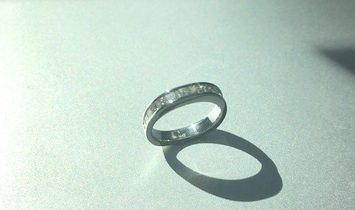 14 Princess cut Diamonds set in a 14k White Gold Band