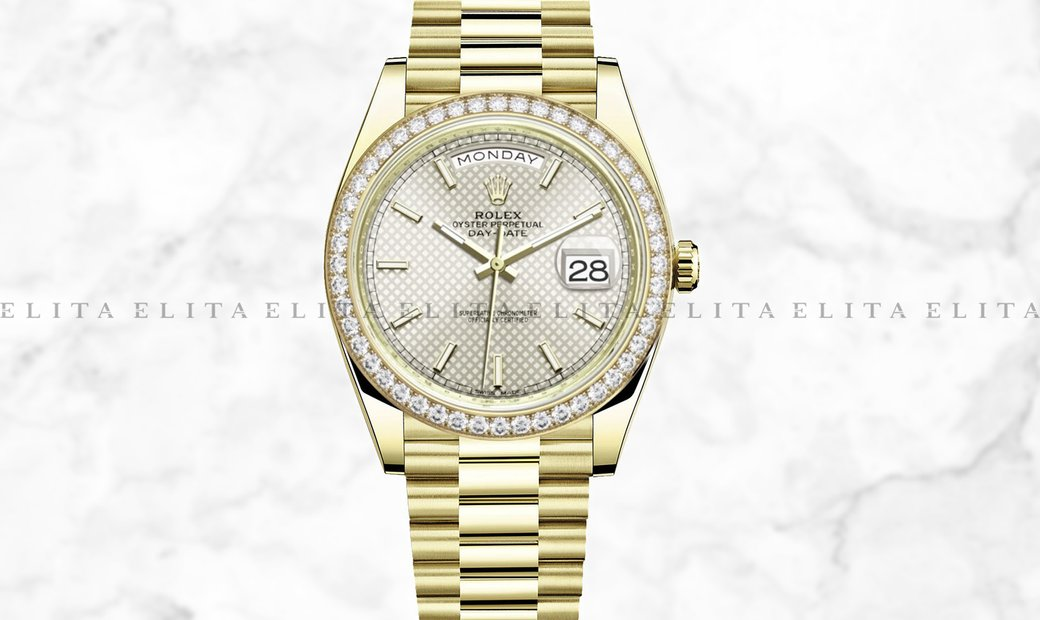 Rolex Day-Date 40 228348RBR-0005 18K Yellow Gold Silver Diagonal Motif Dial Diamond Set Bezel