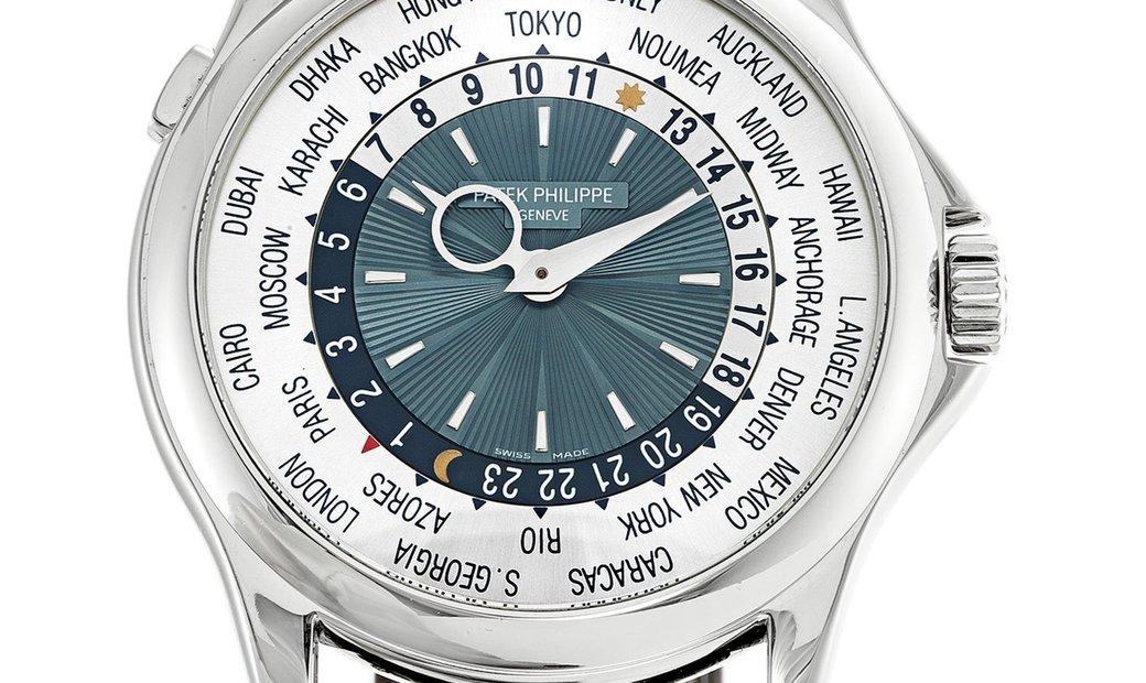 PATEK PHILIPPE COMPLICATIONS WORLD TIME PLATINUM MEN'S WATCH Ref. 5130P-001