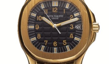 PATEK PHILIPPE AQUANAUT AUTOMATIC YELLOW GOLD 5066/1J-001