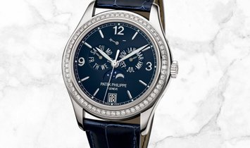 Patek Philippe Complications 5147G-001 Annual Calendar in White Gold Navy Blue Dial Diamond Bezel