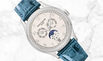 Patek Philippe Complications 4947G-010 Annual Calendar Moon Phases White Gold Silvery Dial