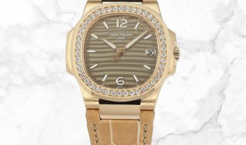 Patek Philippe Nautilus 7010R-012 Date Sweep Seconds Rose Gold Opaline Dial Diamond Bezel