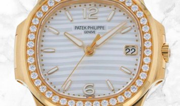Patek Philippe Nautilus 7010R-011 Date and Sweep Seconds Rose Gold Silvery White Dial Diamond Set