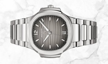 Patek Philippe Nautilus Ladies 7118/1A-011 Stainless Steel Smoked Grey Dial