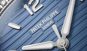 Patek Philippe Nautilus 7118/1200A-001 Ladies Stainless Steel With Blue Opaline Dial Diamond Bezel