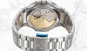 Patek Philippe Nautilus 7118/1200A-010 Ladies Steel Silvery Opaline Dial Diamond Bezel